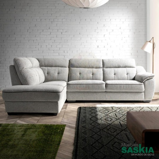 Sofá rinconera tapizado en tela.